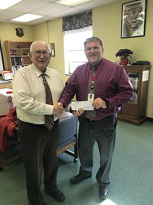 Superintendent David Burkett from Fannett-Metal presents the teacher grant award to Mr. Mattern Mellot.