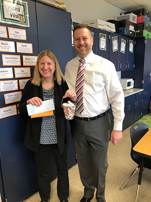 Dr. Christian Haller, principal in the Octorara School District, presents the grant check to Mrs. Christina Gray.