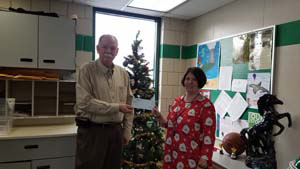 Eric Zelanko, superintendent of Portage SD, presents the PARSS grant check to his staff member.