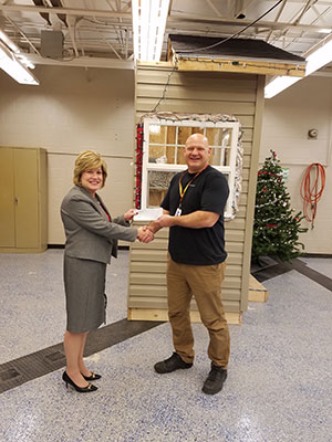 Mrs. Donna Miller, Superintendent, presenting the check to Mr. John Bochicchio, Girard High School Teacher.