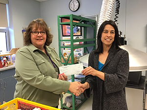 Sarah Batson receives her grant from Superintendent Jacki Canter