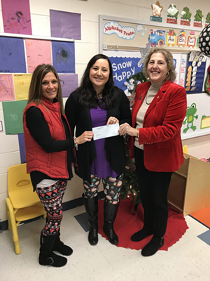 Kayla Graham and Kim Burda receiving PARSS grant check from Superintendent Dr. Barbara Parkins