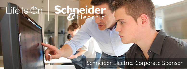 Student and Teacher at Computer | Schneider Electric Sponsor