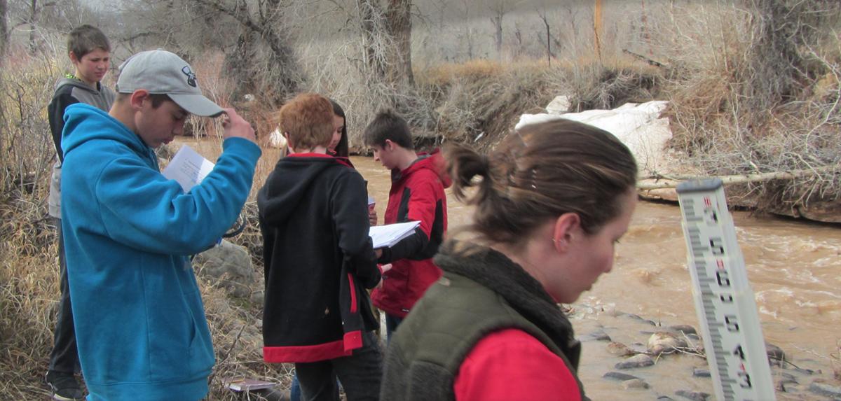 students at river
