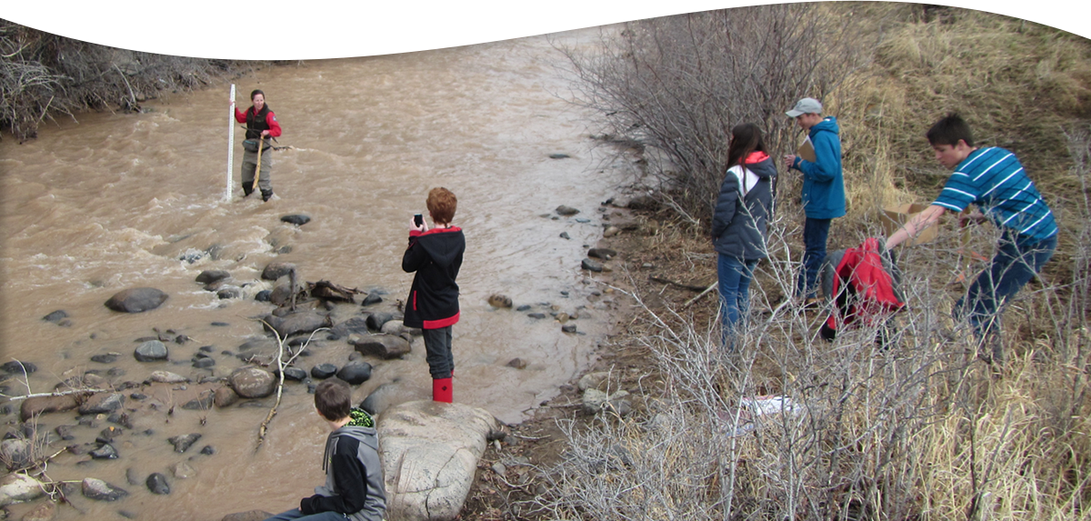 students working at river