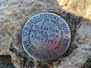 US Geological Survey Bench Mark - the Grand Teton. 13775 feet above sea level