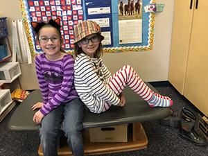 Two students enjoying Dr. Seuss activities