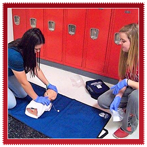 Students practice CPR in the hallway