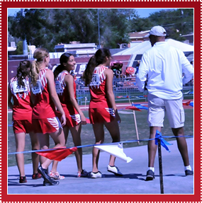 Athletes and coach at a track meet