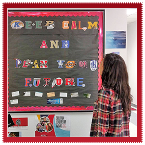 Student stands in front of a sign made out of college logos that reads keep calm and plan your future