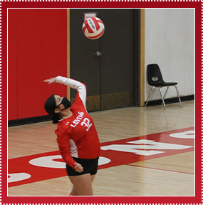 Volleyball player serving ball