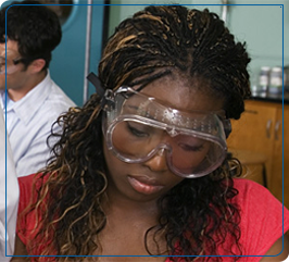 Student wears goggles in a lab