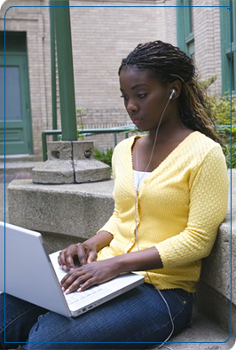 Woman uses a laptop and headphones outside