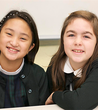 Two smiling students pose together