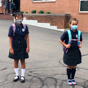 Two St. Rita students wearing face masks for safe learning during Pandemic