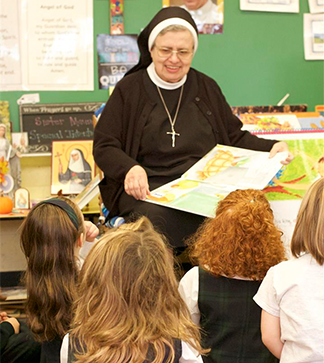 Nun reads to students