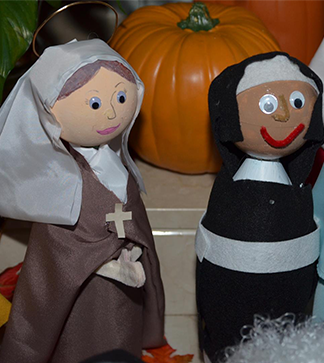 Painted figures of nuns