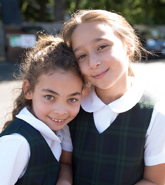 Two young female students pose together