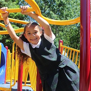 Happy school girl on the playground