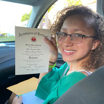 Happy middle school student holding up certificate
