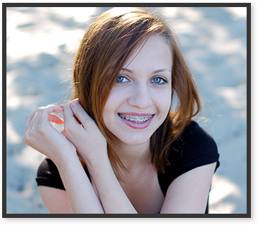 girl with braces outside