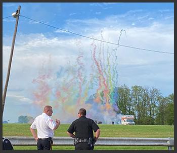 color powder exploding to congratulate the graduates