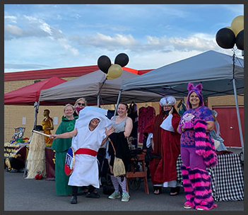 teachers posing together in costumes
