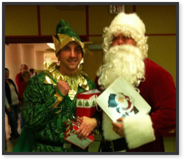 Staff members dressed as Santa Claus and an elf