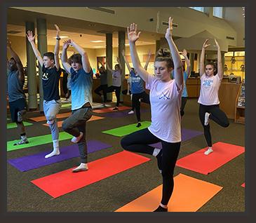 More students enjoying yoga activity