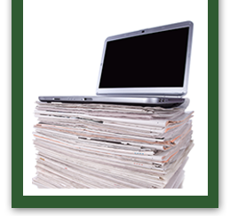 Laptop on a stack of newspapers