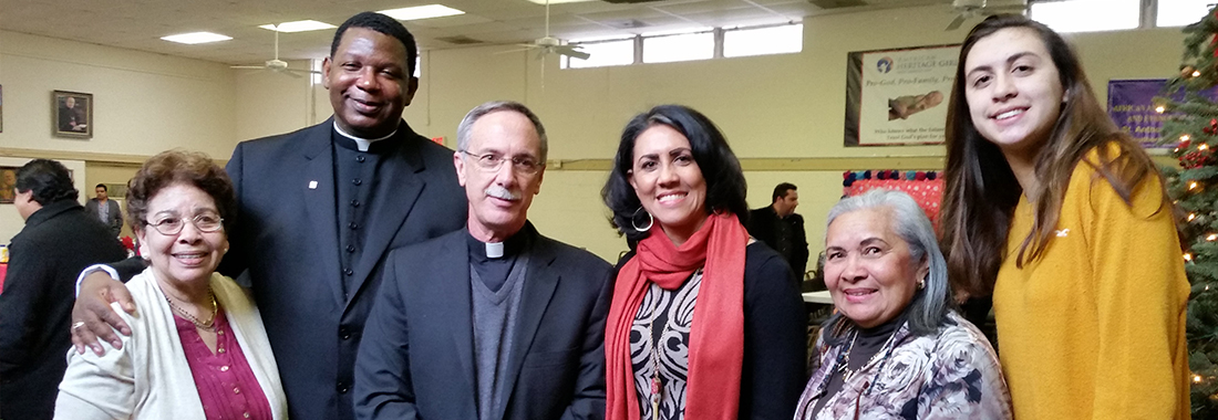 Bishop Luis Raphael Zarama, Father Andrew McNair and a Church Family