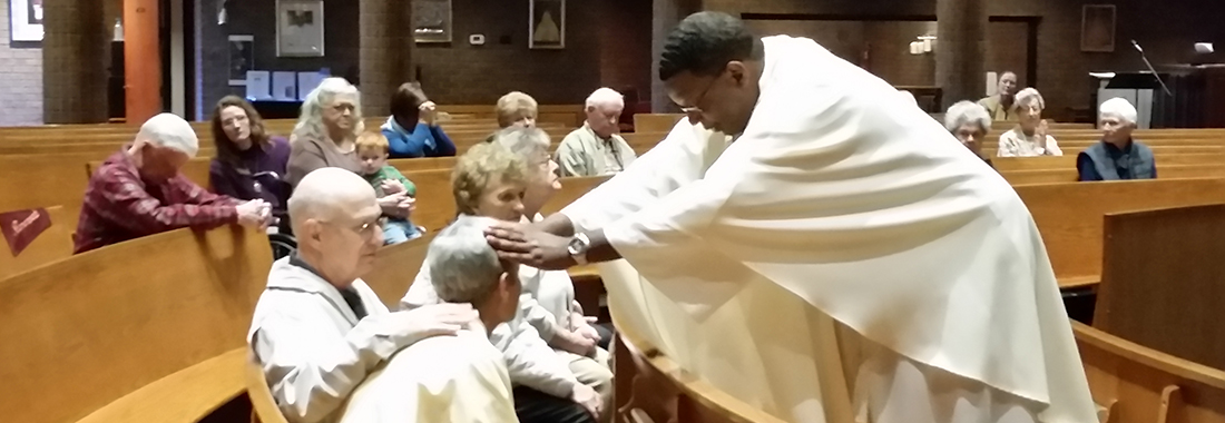 Father Andrew McNair Laying on of Hands