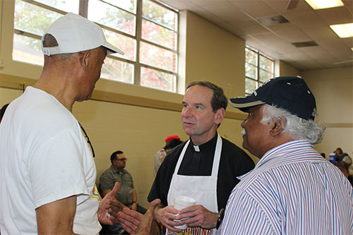Our Bishop serving at our Thanksgiving Meal