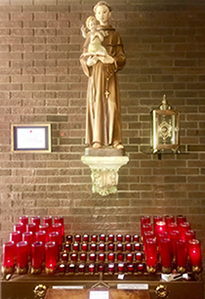 Church figure and candle altar
