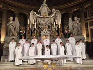 French boys choir standing in church