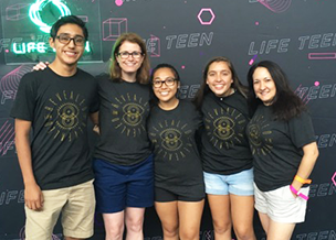 Five StAY youth members in Atlanta smiling with matching black T-Shirts