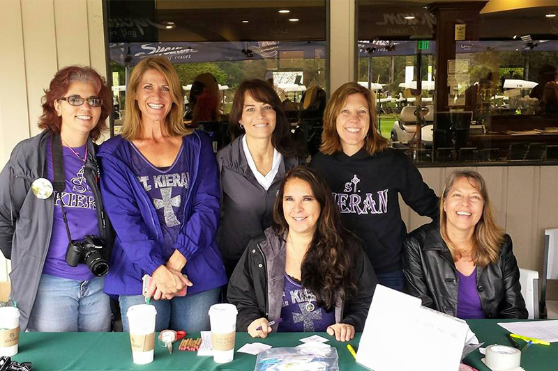 Women working table at golf tournament