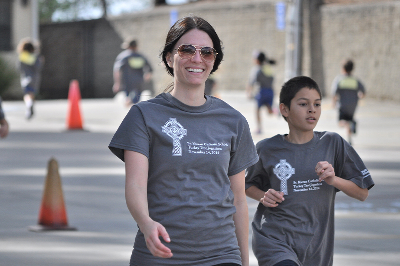 Woman and boy jogging
