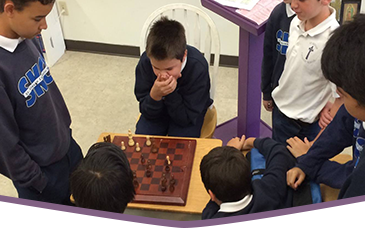 Male students play chess