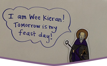 Drawing of a small St. Kieran of Saighir with a speech bubble reading I am Wee Kieran! Tomorrow is my feast day!