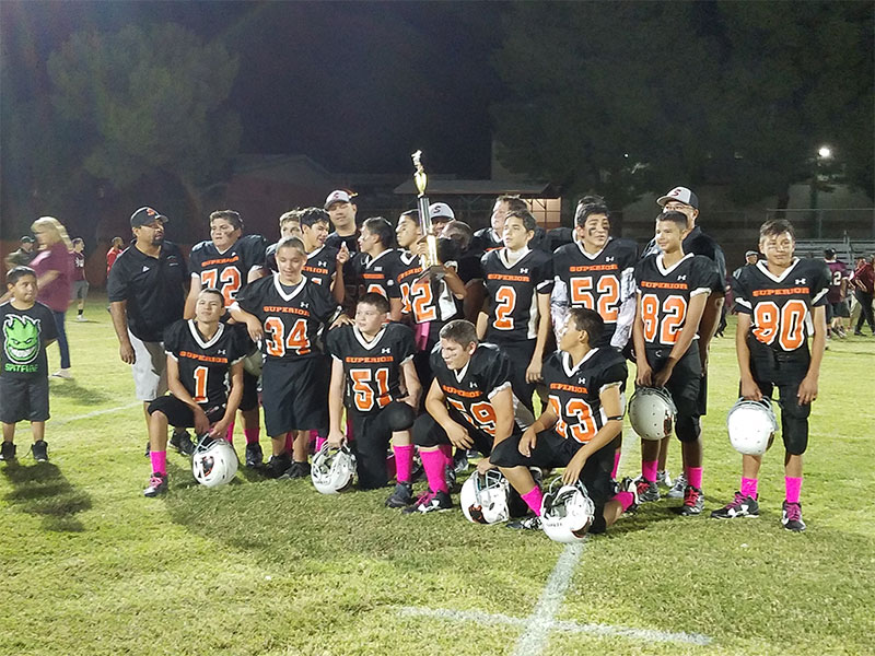Superior Junior High School football team poses after defeating the Ray Bearcats to win the championship game.