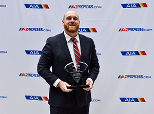 Coach Ryan Palmer poses with his AIA 2018-2019 Coach of the Year award