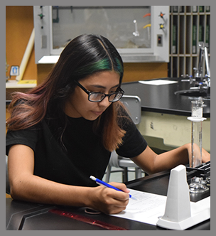 Two students work on a project in a lab
