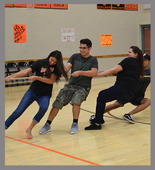 Students play tug of war in the gym