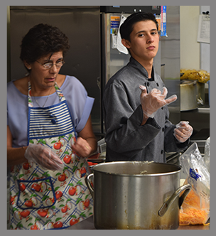 Student and teacher work in a kitchen