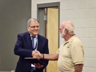 American Legion Commander Joe Frame honors Supt. Joraanstad for coaching Orators.