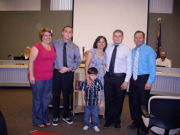 From left: Juniors Jimmy Moreland, with teacher Lisa Schroeder, and Jose Camacho, with parents, chosen to attend Arizona Boys' State.