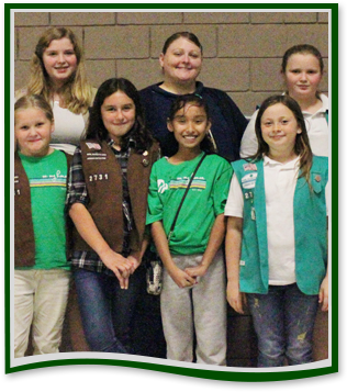 Students involved in girls clubs pose with an adult