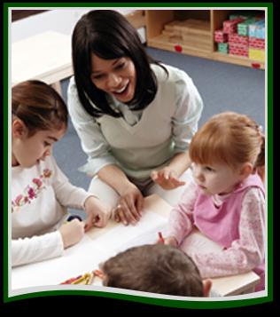 Teacher helps preschool students with an activity