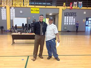 Eddie Villalba poses with a staff member